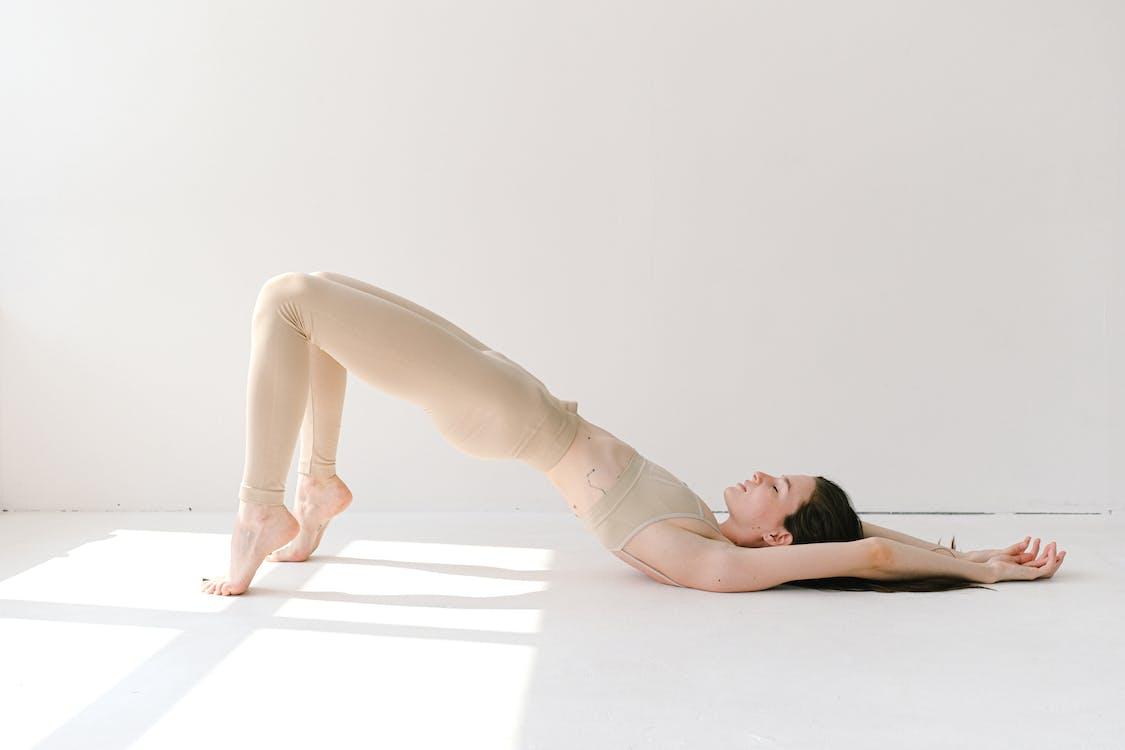 Woman in White Leggings Lying on Floor