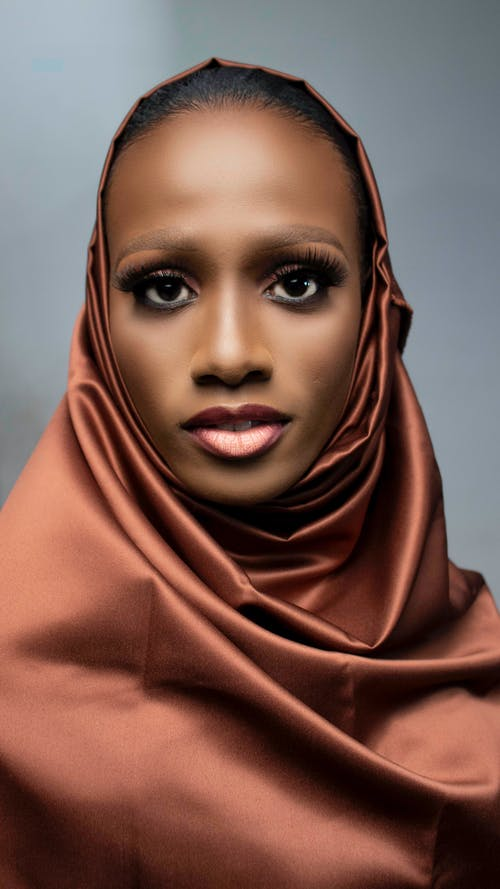 Black woman with bright makeup in hijab
