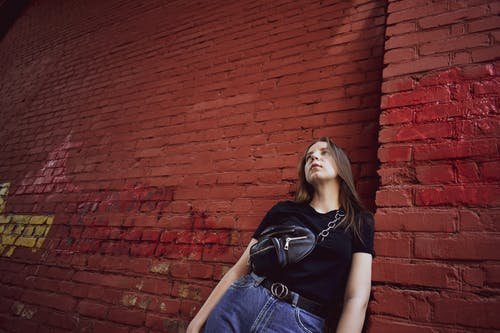 Free stock photo of arch, girl, red brick, wall
