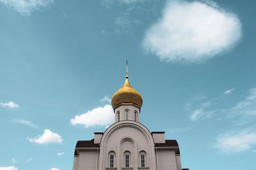 White and Gold Dome Building Under Blue Sky