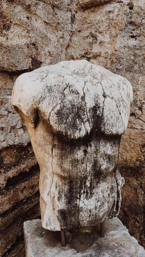 Ancient statue of male naked torso