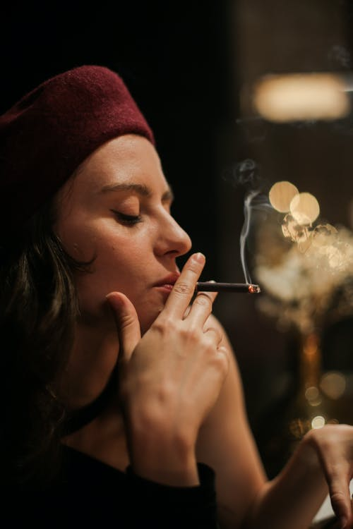 Woman in Red Knit Cap Smoking Cigarette