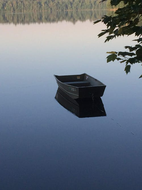 Black Boat on Calm Water