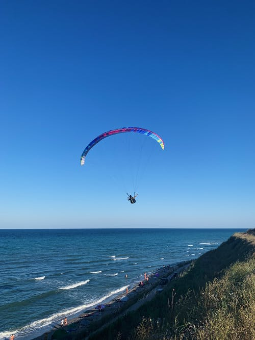 Person in Parachute over the Sea