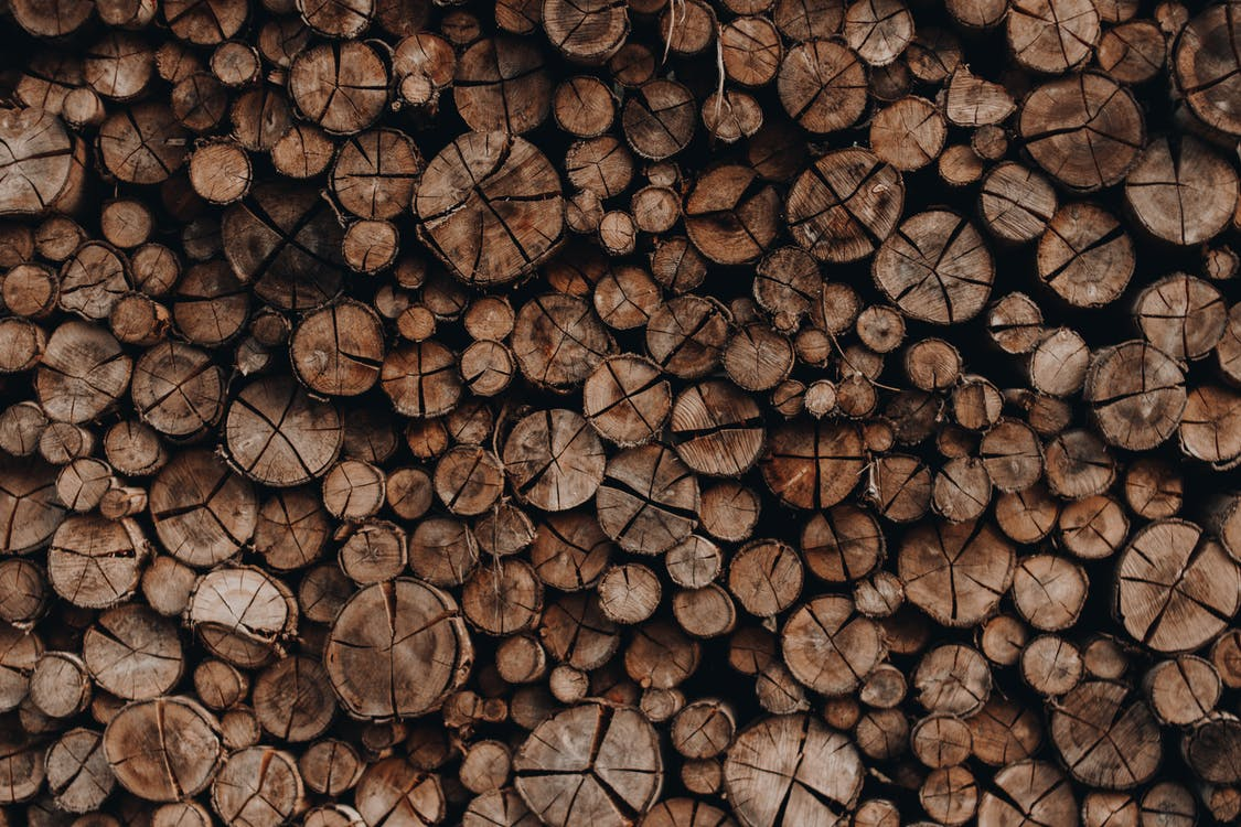 Pile of wooden skids with cracks stacked accurately in rows arranged for cutting