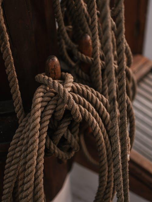 Brown Rope Tied on Brown Wooden Post