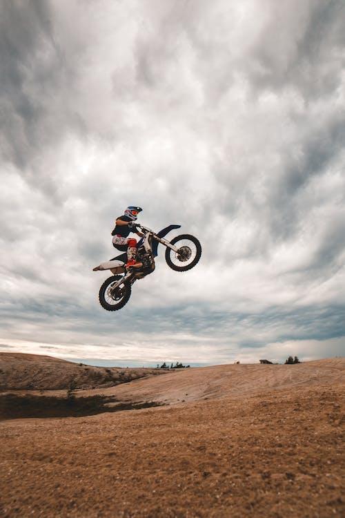 Anonymous man doing stunt on bike