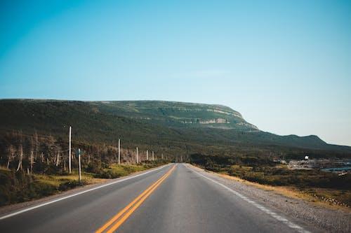 Asphalt road leading to mountain