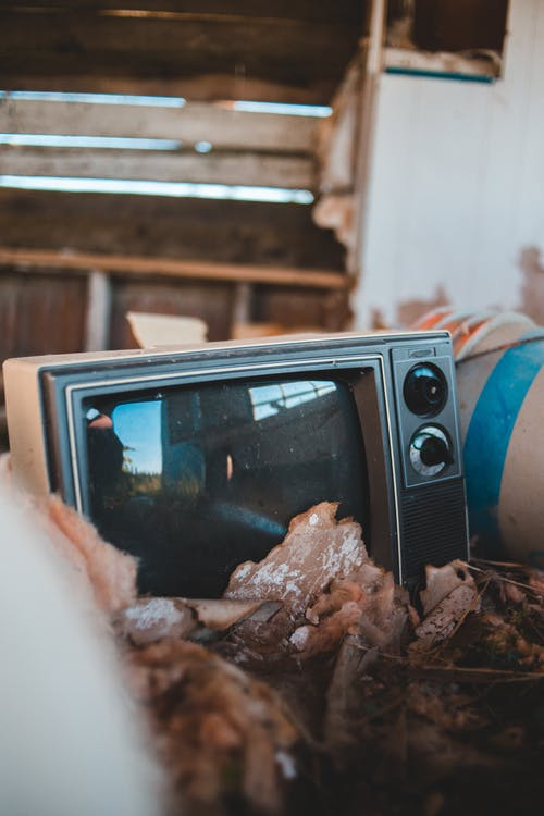 Retro television in old destructed wooden house