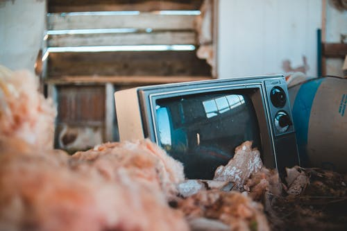 Old TV in shabby barn in countryside