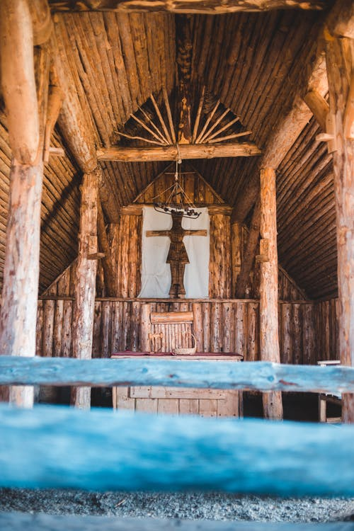Low angle of cross in old wooden church located in Norstead Vikng Village on sunny day
