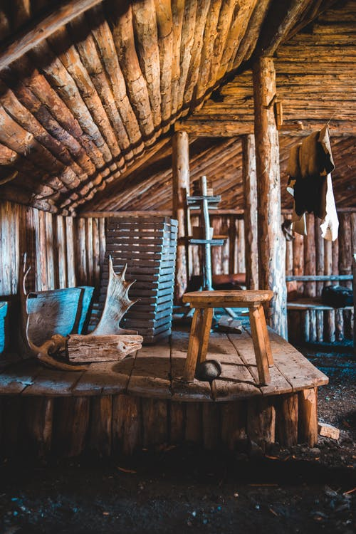 Interior of old authentic wooden Nordic house with rustic interior and decorative horns in Norstead Viking Village