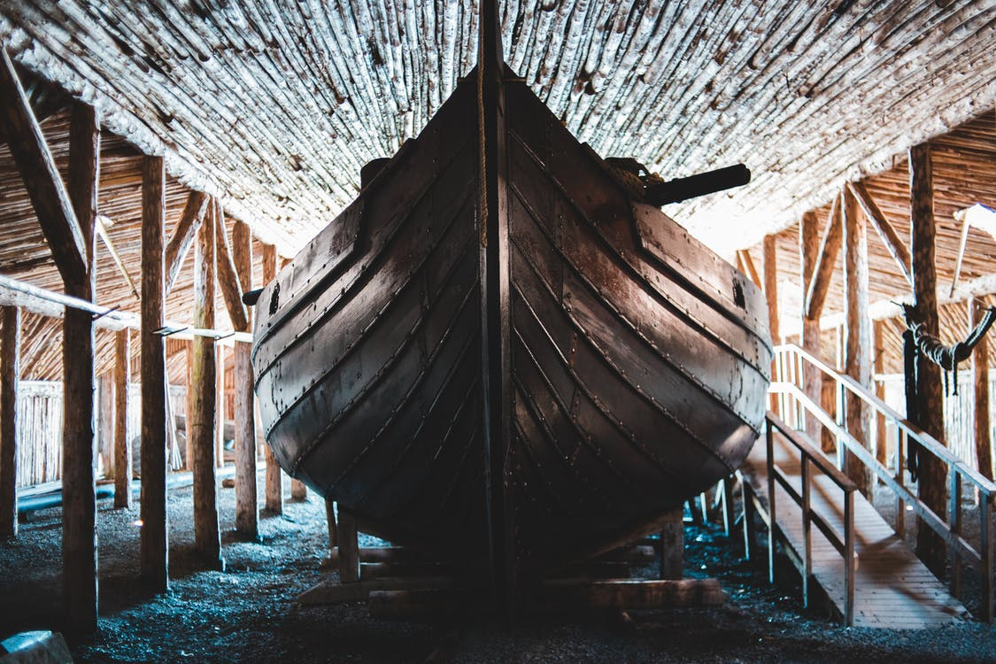 Traditional wooden Viking boat in aged village