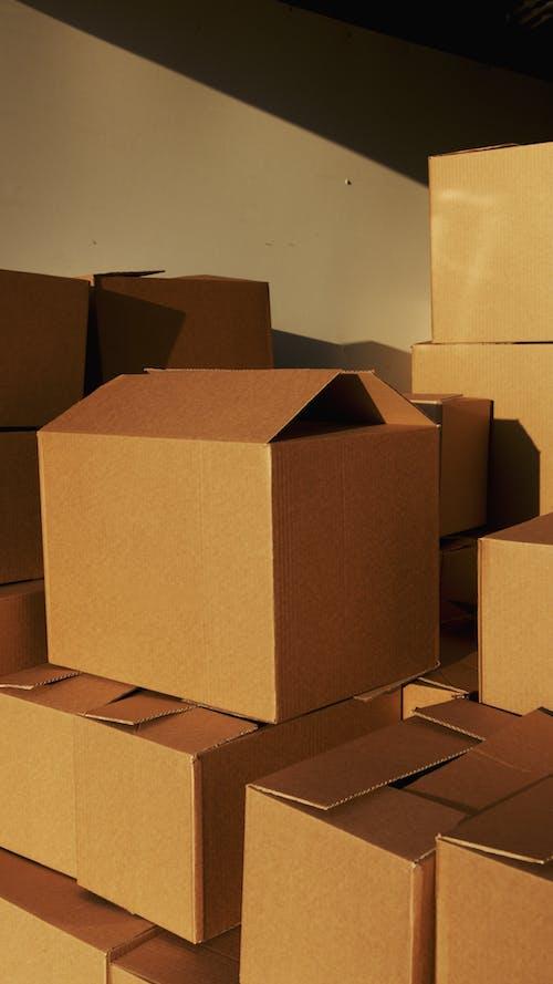 Brown Cardboard Box on White Floor
