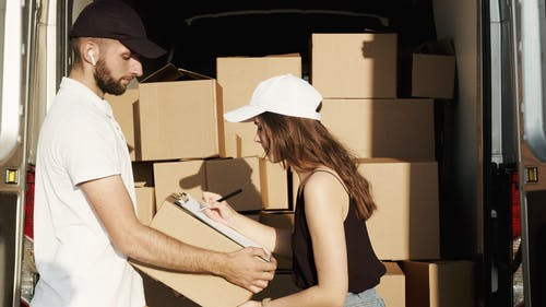 Woman Receiving the Package from the Deliveryman