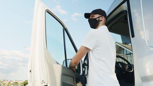 Бесплатное стоковое фото с covid-19, водитель, дверь автомобиля
