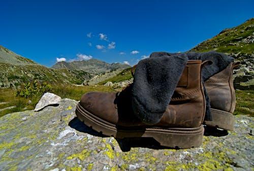 Free stock photo of boty, černé ponožky, cil, cíl cesty