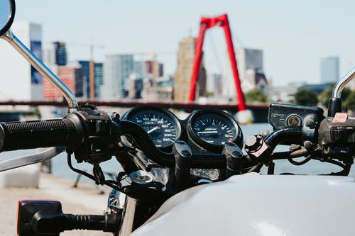 Black Motorcycle in Front of Red Metal Bar