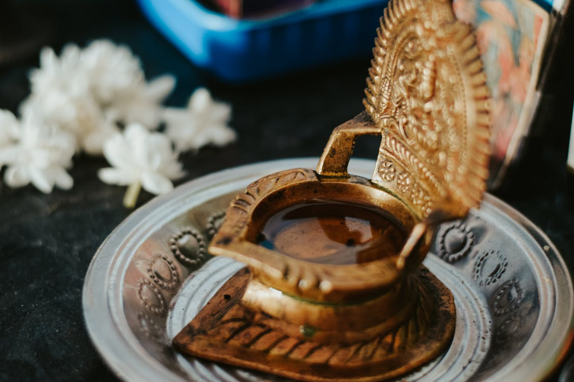 Brown Ceramic Mug on Stainless Steel Round Tray