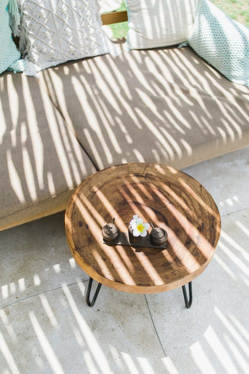 Black and Yellow Toy on Brown Wooden Round Table