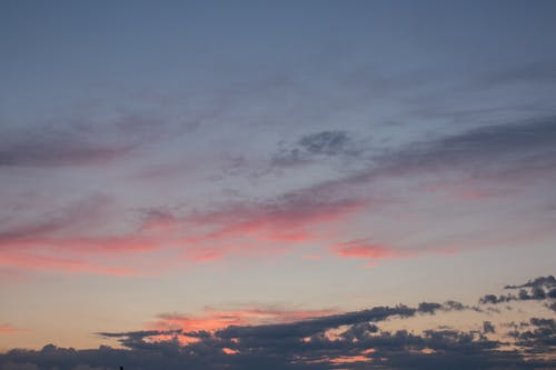 Cloudy sky in pink colors of sunset