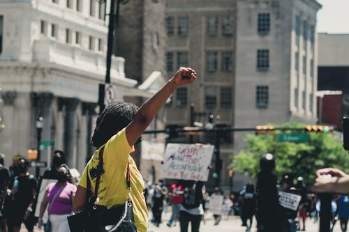 Black woman protesting on city street
