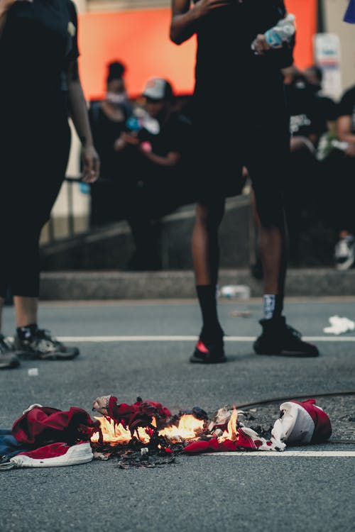 Flaming clothes and shoes on pavement