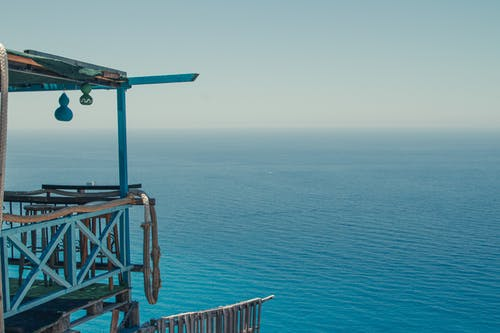 Balcony of lifeguard tower in front of blue ocean