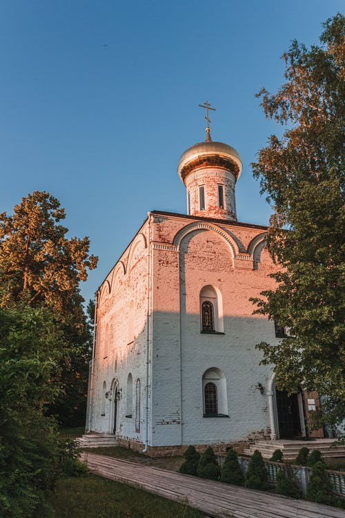 Ancient church in countryside at sundown