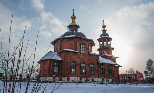 Old wooden church in winter day
