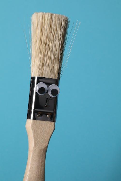 Free stock photo of blue background, brush, googly eyes