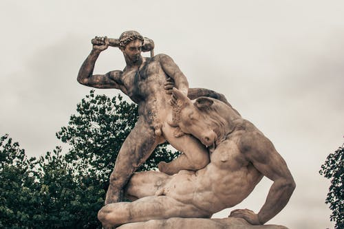 Man Holding a Skull Statue