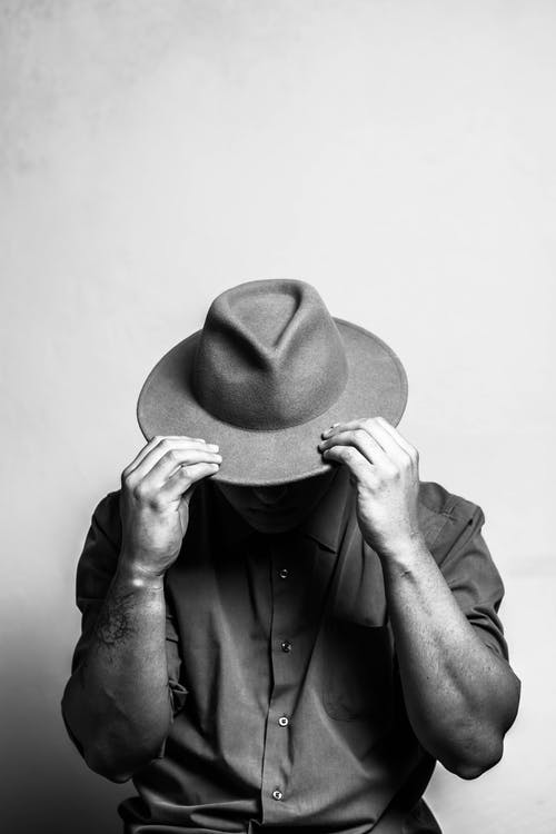Grayscale Photo of Person Wearing Hat