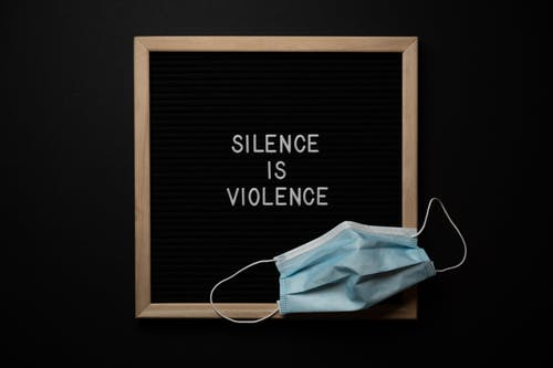 Composition of framed Silence Is Violence inscription on black background with face mask