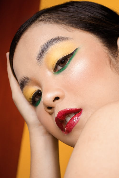Woman With Red Lipstick and Green Eyeshadow