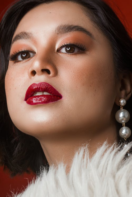 Woman With Red Lipstick and White Pearl Earrings