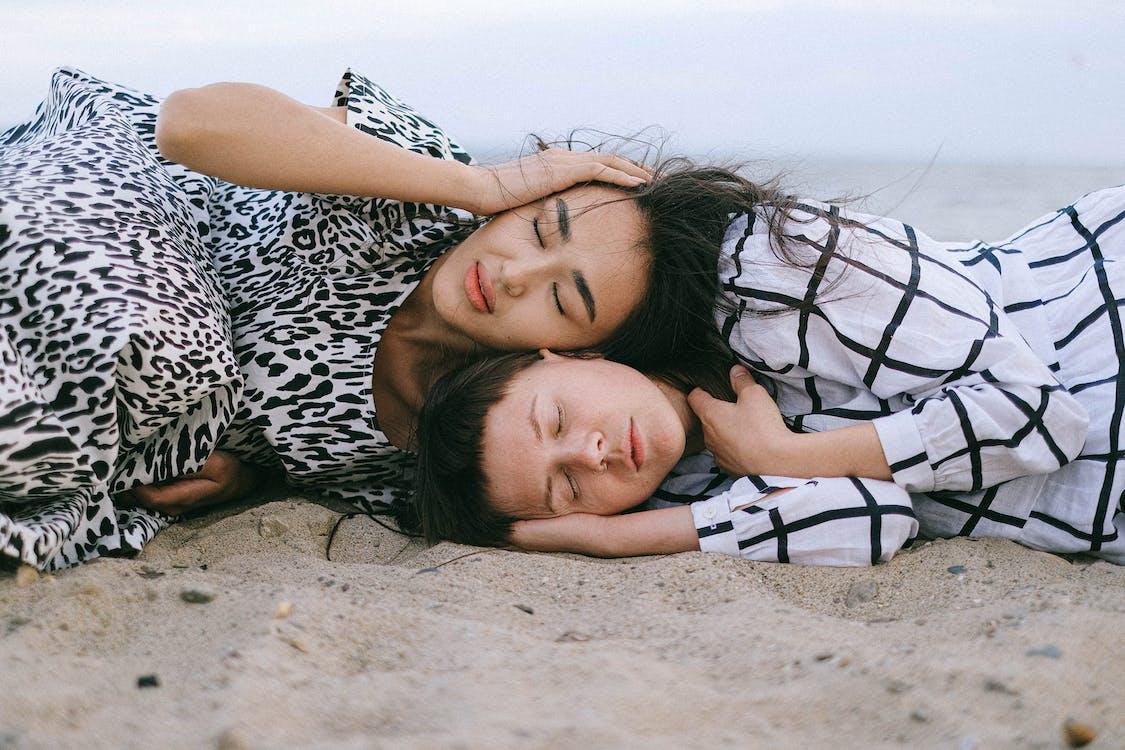 Women Lying on Beach Sand