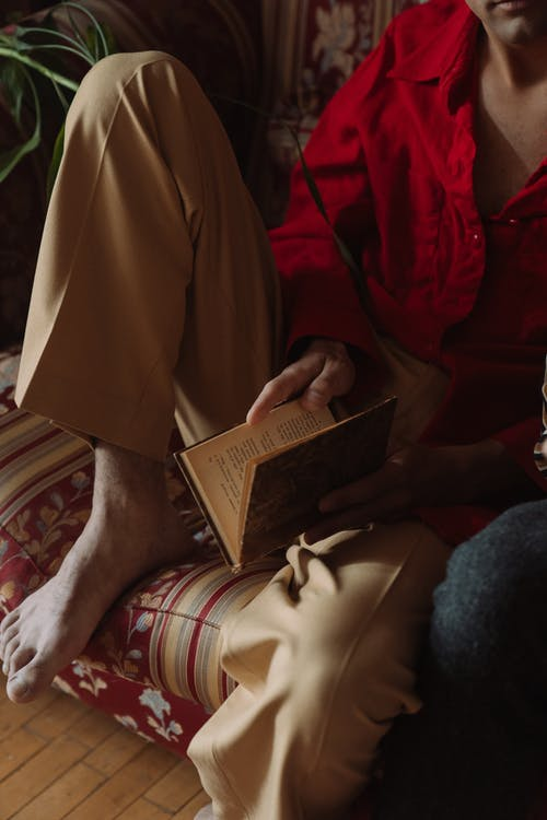 Person Reading Book on Lap