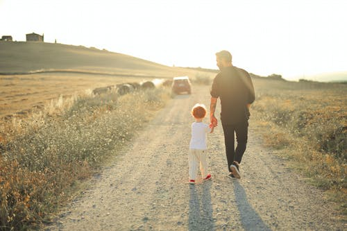 Man and Woman Walking on Dirt Road