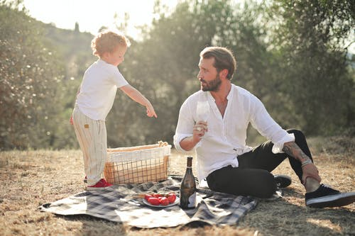 Man and a Child on a Picnic Blanket