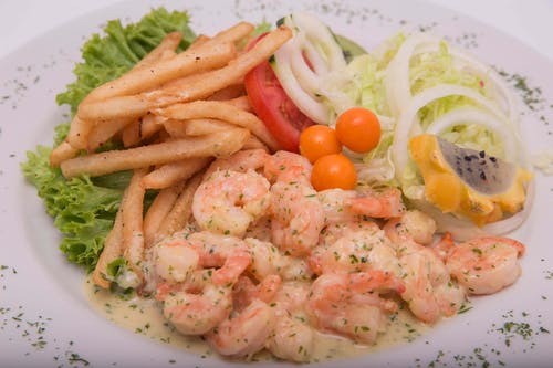 Prawns With Sliced Onions and Vegetables on White Ceramic Plate