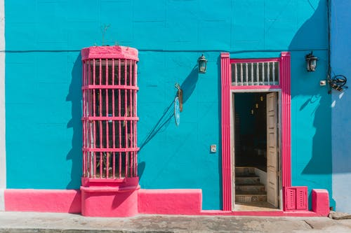 Blue Wall with Pink Window and Door Opening