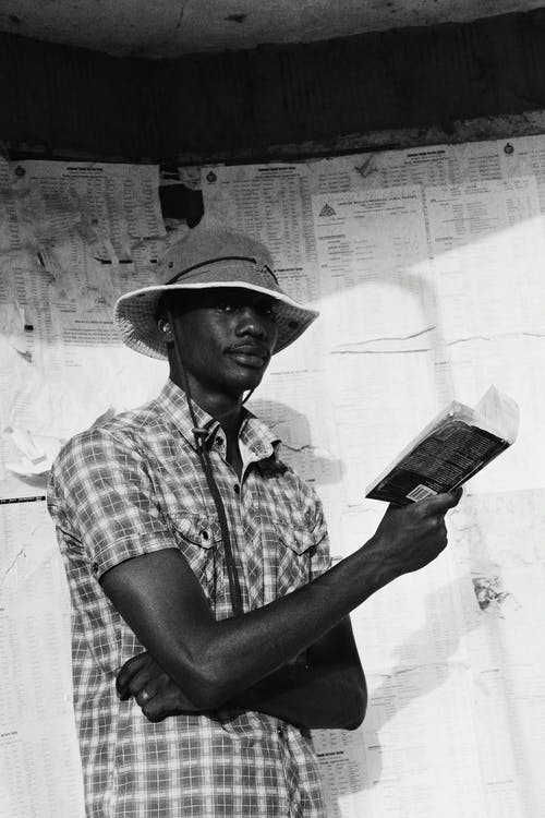 Pensive black man with book