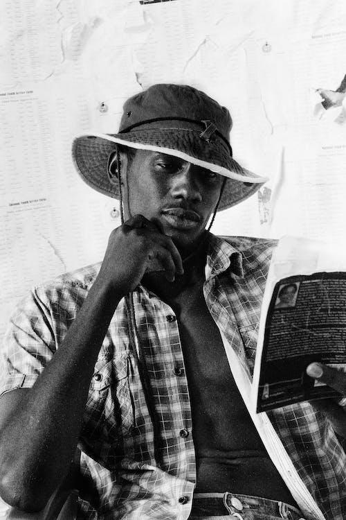 Serious black man reading book
