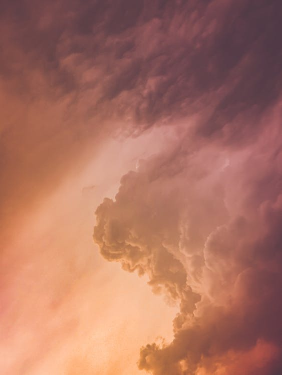 Breathtaking sunset sky with fluffy clouds