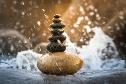 Pyramids of stones in water splashes