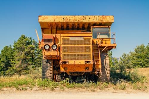 Rusty tipper truck on field in countryside