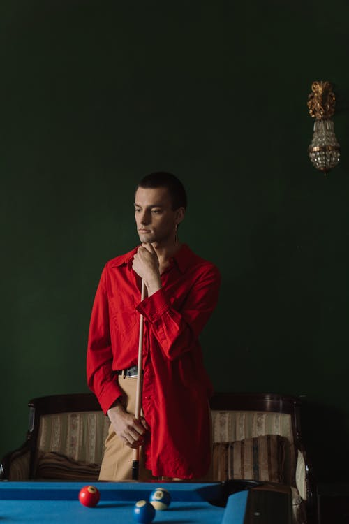 Man in Red Robe Standing