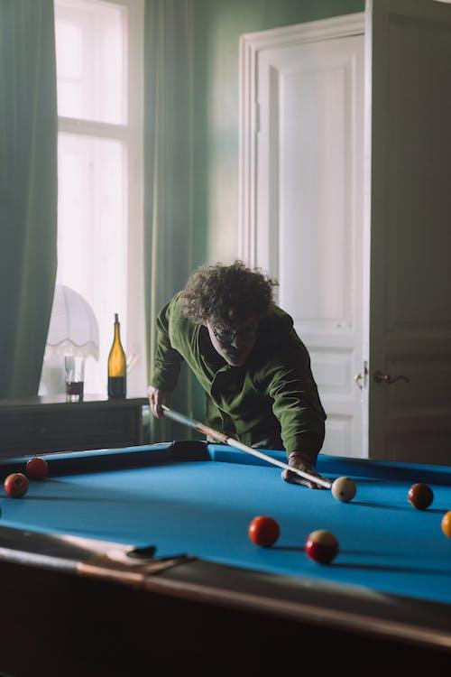 Man in Black Long Sleeve Shirt Playing Billiard