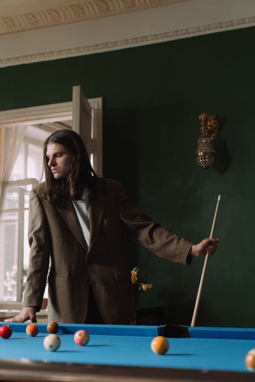 Woman in Black Blazer Holding Stick